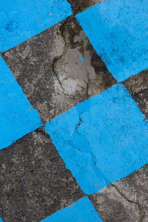 mosaic floor: Antique stone floor painted in black and blue mosaic. Vertical background