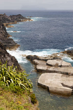 natural pool: Azores coastline landscape with natural pool in Flores island. Portugal. Vertical