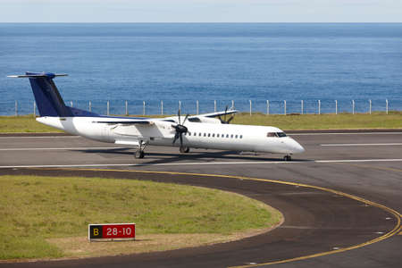 just arrived: Aeroplane on the airport runaway near the ocean just arrived. Horizontal