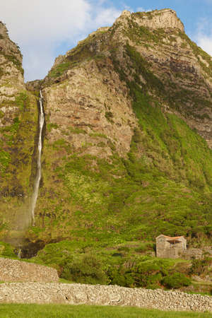 flores: Landscape with waterfall in Faja Grande, Flores island. Azores, Portugal. Vertical Stock Photo