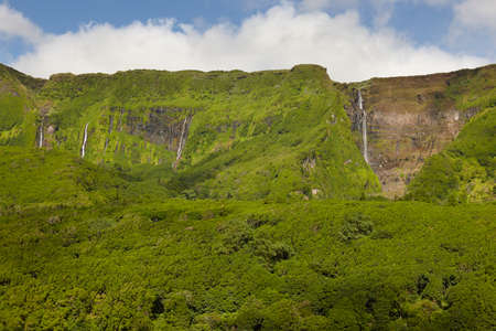 flores: Azores landscape with waterfalls and cliffs in Flores island. Portugal. Horizontal