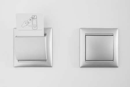 light switch: Hotel open room card system with light switch white wall. Horizontal Stock Photo