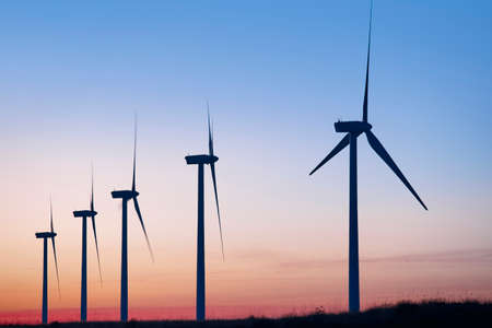 electric energy: Wind mill farm at dusk. Global warming. Sustainable energy. Power Stock Photo