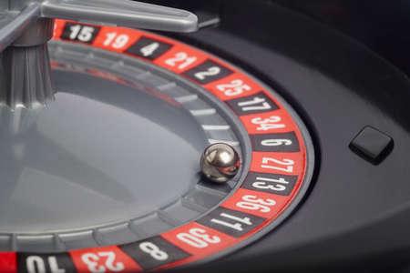 thirteen: Casino roulette detail with ball in number thirteen. Gambling. Horizontal