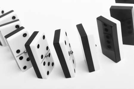 Domino game with pieces over a white background. Black, white. horizontal