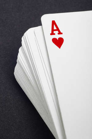 jack of hearts: Card game with ace of hearts detail. Black background. Vertical Stock Photo