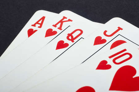 straight flush: Poker card game with heart straight flush. Red. Vertical