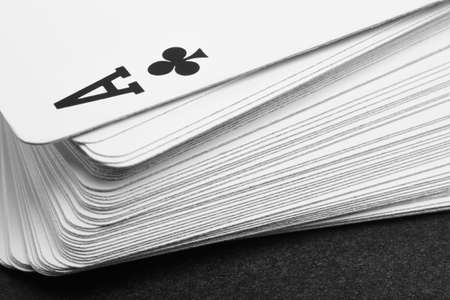the detail: Card game with ace of clubs detail. Black and white. Horizontal