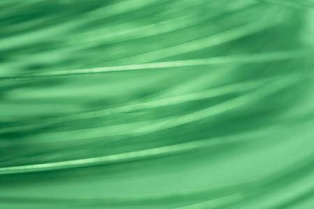 horizontal format: Green tone abstract metallic background. Defocused. Horizontal format