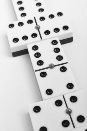 Domino game with pieces over a white background. Black, white. Detail 版權商用圖片