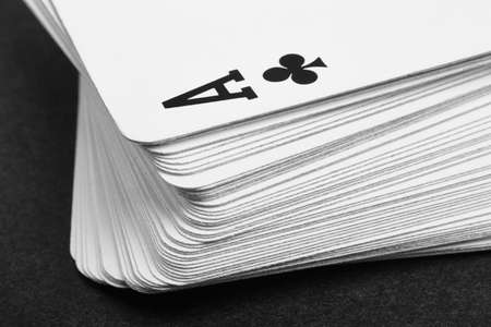 ace of clubs: Card game with ace of clubs detail. Black and white. Horizontal