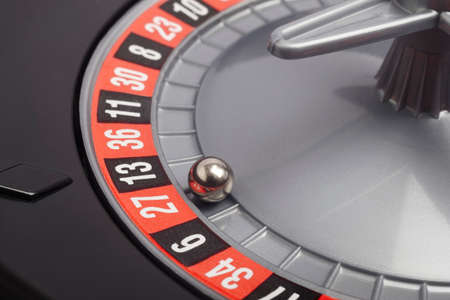 roulette wheel: Casino roulette detail with ball in number twenty seven. Gambling. Horizontal Stock Photo