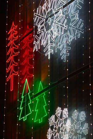 Christmas lights decoration on a building facade. Vertical