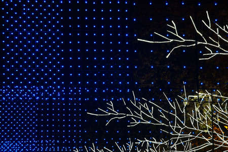 city lights: City christmas lights decoration by night. Blue and white. Horizontal