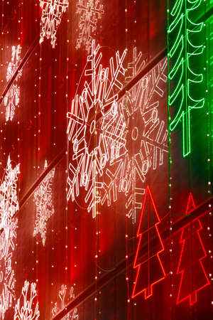 Christmas lights decoration on a building facade in warm tone. Vertical