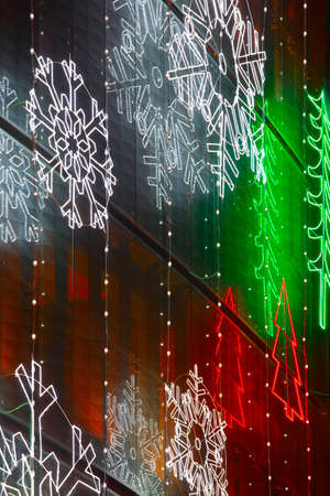 publicly: Christmas lights decoration on a building facade. Vertical