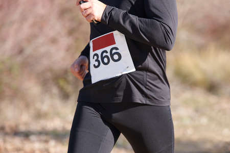 sport training: Young athletic runners on a cross country race. Outdoor circuit. Horizontal Stock Photo