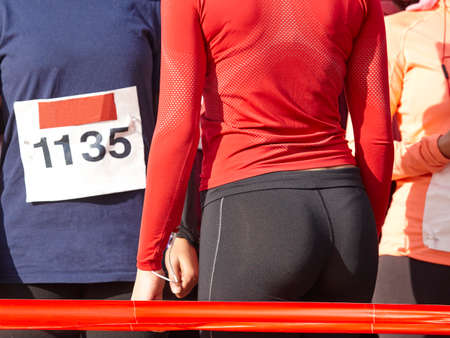 horizontal format: Young female athletic runners detail ready to run. Start zone. Horizontal format
