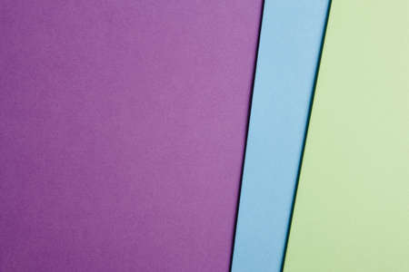 cardboards: Colored cardboards background in blue, green, purple tone. Copy space. Horizontal