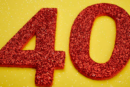 40: Number forty red color over a yellow background. Anniversary. Horizontal