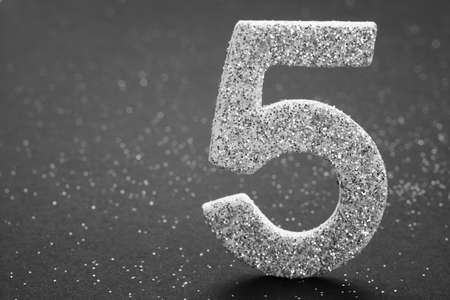 Number five silver color over a grey background. Anniversary. Horizontal Stok Fotoğraf