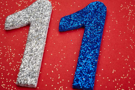 number eleven: Number eleven silver blue color over a red background. Anniversary. Horizontal