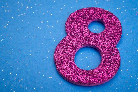 8 years birthday: Number eight purple color over a blue background. Anniversary. Horizontal