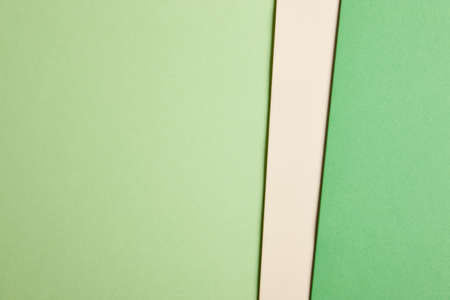 cardboards: Colored cardboards background in green beige tone. Copy space. Horizontal