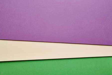 green tone: Colored cardboards background in purple beige green tone. Copy space. Horizontal