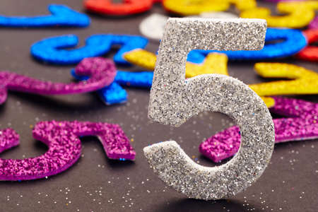 age 5: Number five silver color over a colored background. Anniversary. Horizontal Stock Photo
