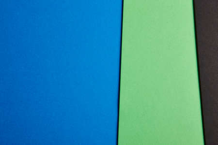 green and black: Colored cardboards background in blue, green, black tone. Copy space. Horizontal