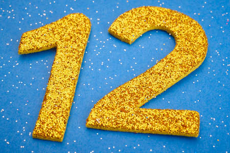 twelve: Number twelve yellow color over a blue background. Anniversary. Horizontal