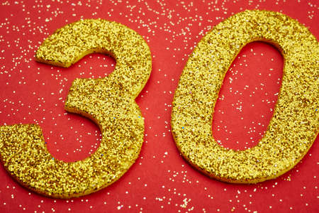 thirty: Number thirty yellow color over a red background. Anniversary. Horizontal