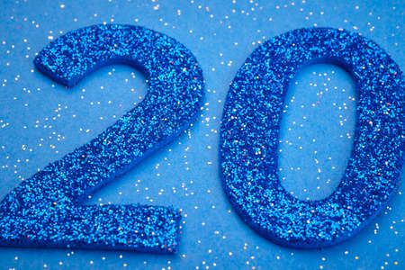 twenty: Number twenty blue color over a blue background. Anniversary. Horizontal Stock Photo