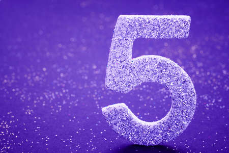 Number five purple color over a purple background. Anniversary. Horizontal