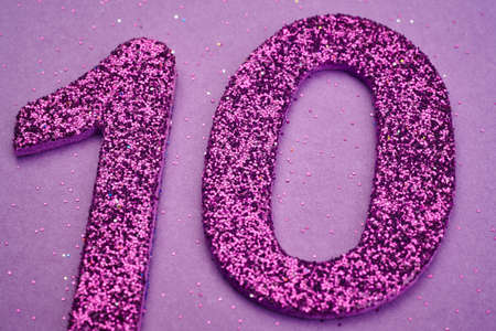 number ten: Number ten purple color over a purple background. Anniversary. Horizontal