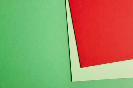 Colored cardboards background in green red tone. Copy space. Horizontal