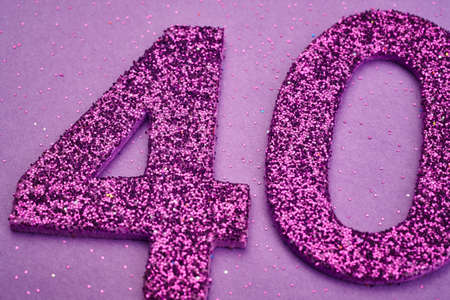 40: Number forty purple color over a purple background. Anniversary. Horizontal