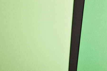 green and black: Colored cardboards background in green black tone. Copy space. Horizontal Stock Photo