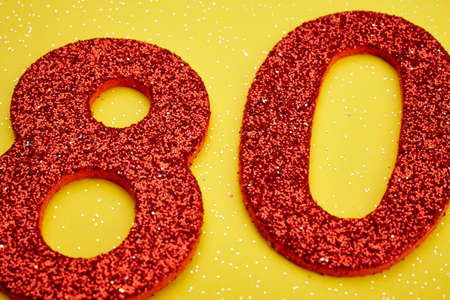 eighty: Number eighty red color over a yellow background. Anniversary. Horizontal