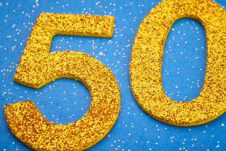 0 1 year: Number fifty yellow color over a blue background. Anniversary. Horizontal Stock Photo