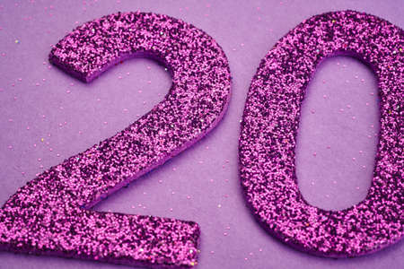 Number twenty purple color over a purple background. Anniversary. Horizontal