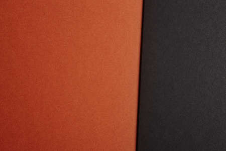 Colored cardboards background in brown black tone. Copy space. Horizontal