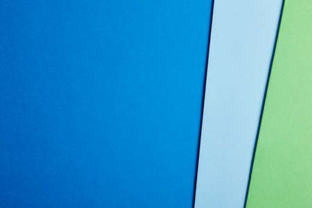 green tone: Colored cardboards background in blue green tone. Copy space. Horizontal Stock Photo