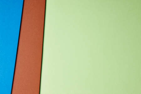 green brown: Colored cardboards background in green brown blue tone. Copy space. Horizontal
