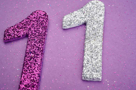 eleven: Number eleven purple silver color over a purple background. Anniversary. Horizontal Stock Photo