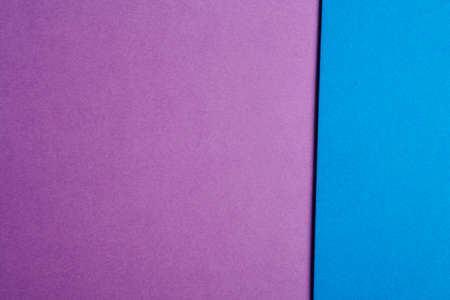 tone: Colored cardboards background in purple blue tone. Copy space. Horizontal