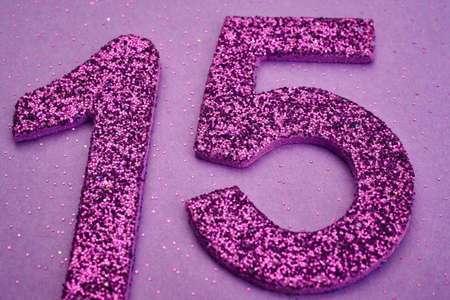 fifteen: Number fifteen purple color over a purple background. Anniversary. Horizontal Stock Photo