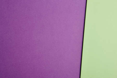 tone: Colored cardboards background in purple green tone. Copy space. Horizontal