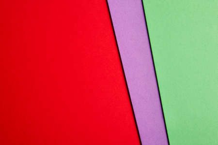 green tone: Colored cardboards background in red purple green tone. Copy space. Horizontal